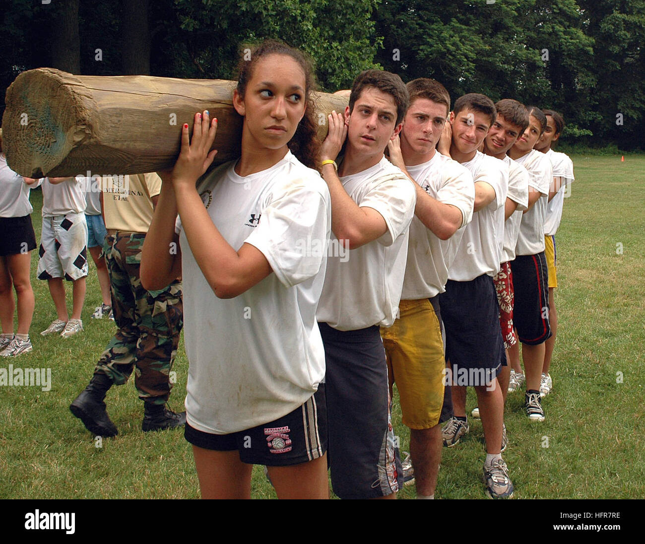 060620-N-5215E-001 Annapolis, Md. (June 22, 2006) - High school students participate in log PT as part of the U.S. Stock Photo