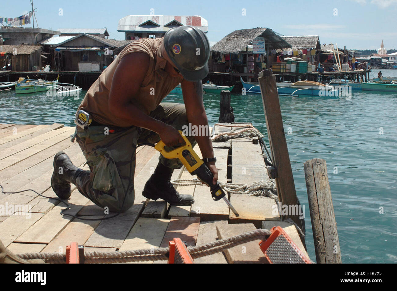 060617-N-9076B-181 Tawi Tawi, Philippines (June 17, 2006) -Navy Builder 3rd Class Juston Haller assigned to Naval Stock Photo