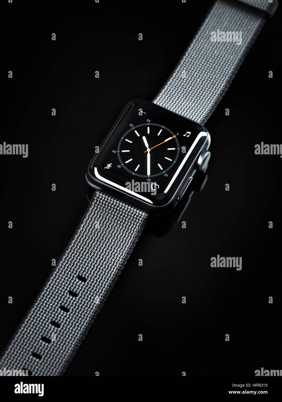Apple Watch, smartwatch with analogue clock dial on display - Stock Image