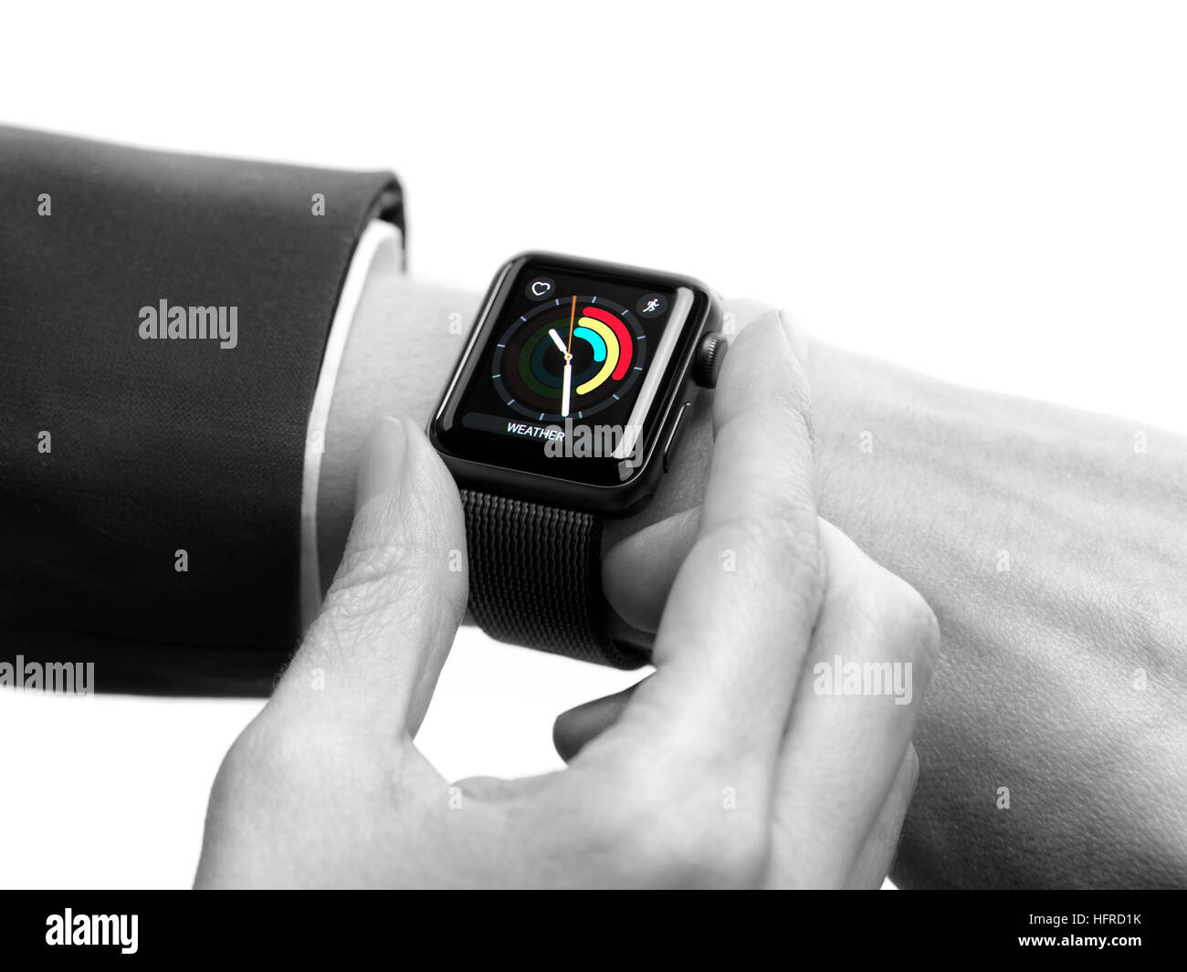 Woman hand with Apple Watch, smartwatch on her wrist, displaying daily activity and exercise - Stock Image
