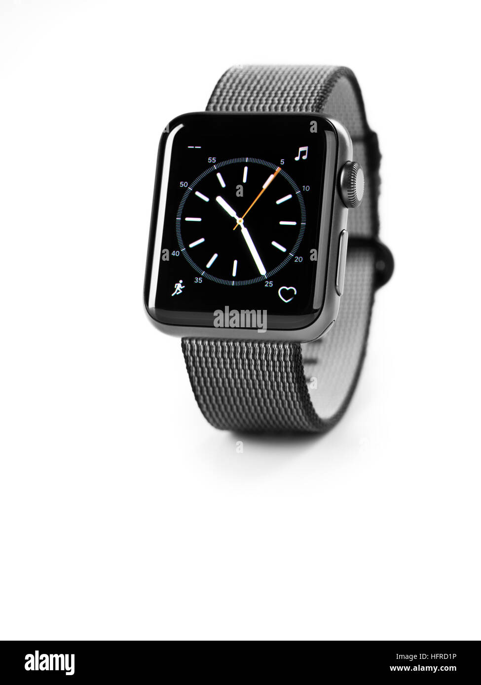 Apple Watch, series 2, smartwatch with analog clock dial on its display - Stock Image