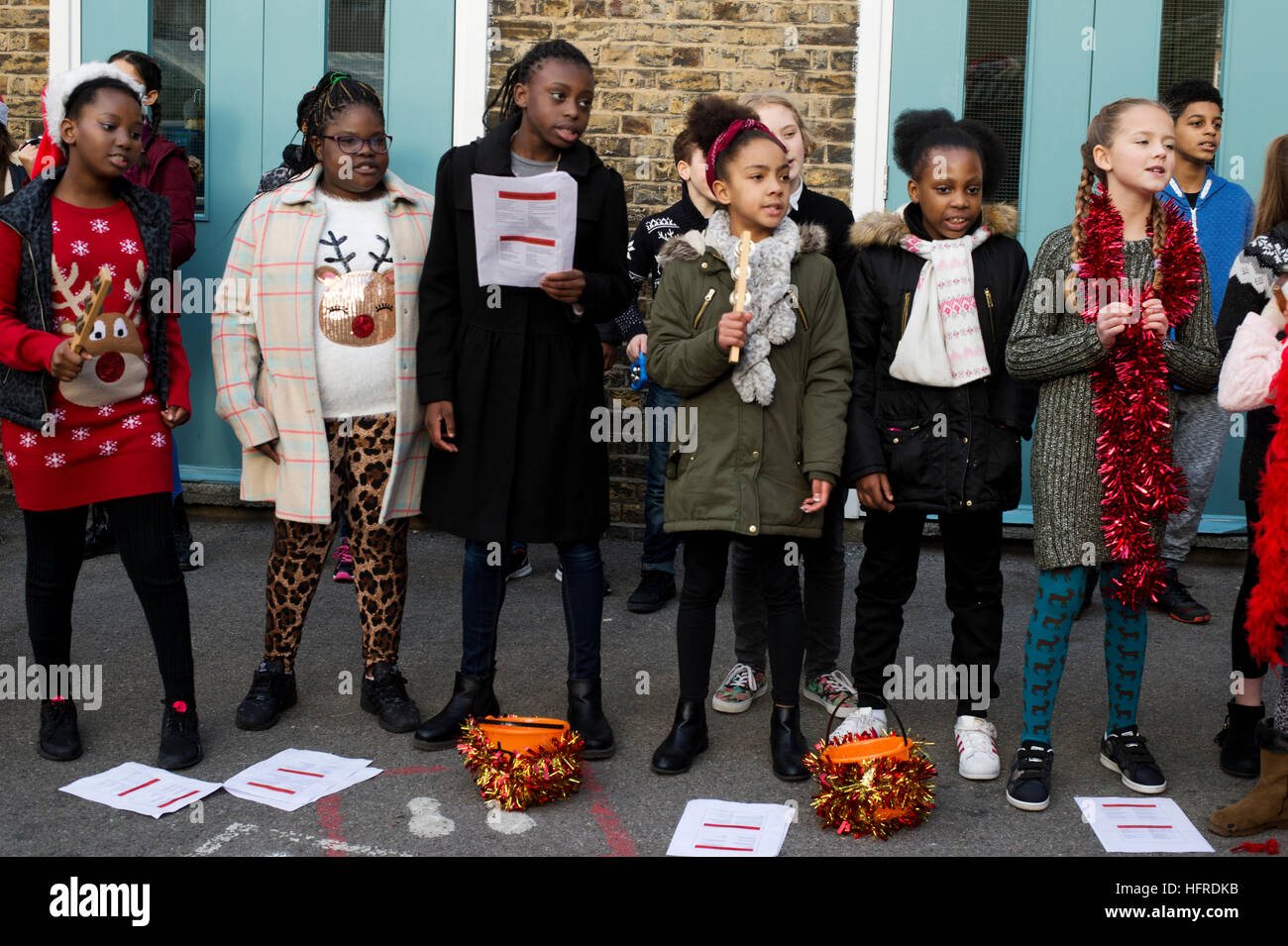 Hackney. Young carol singers raising money for charity. - Stock Image