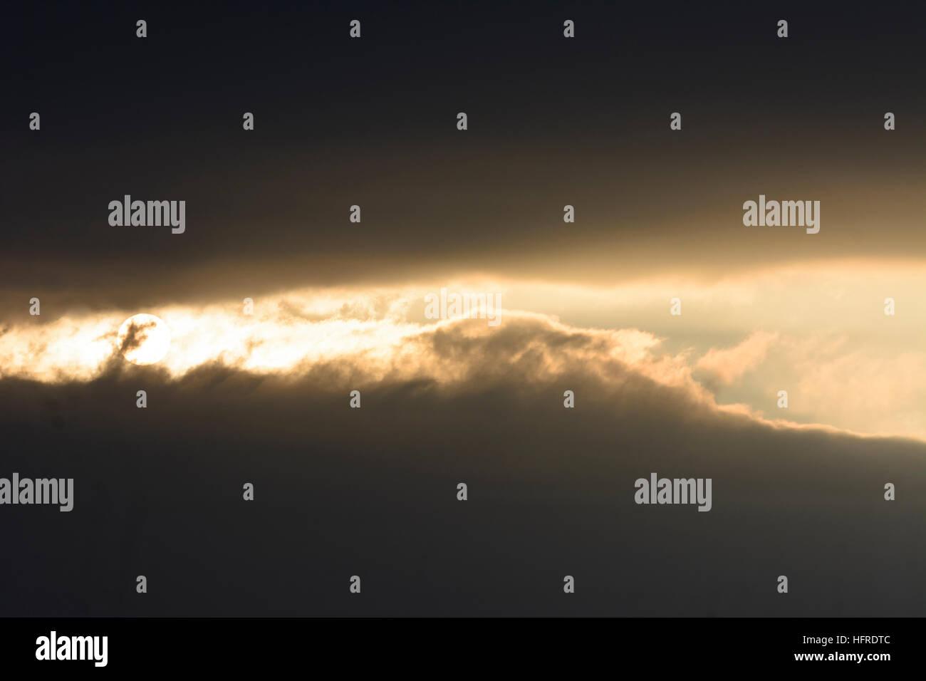 : the sun breaks through dark clouds cloud sky, , Austria - Stock Image