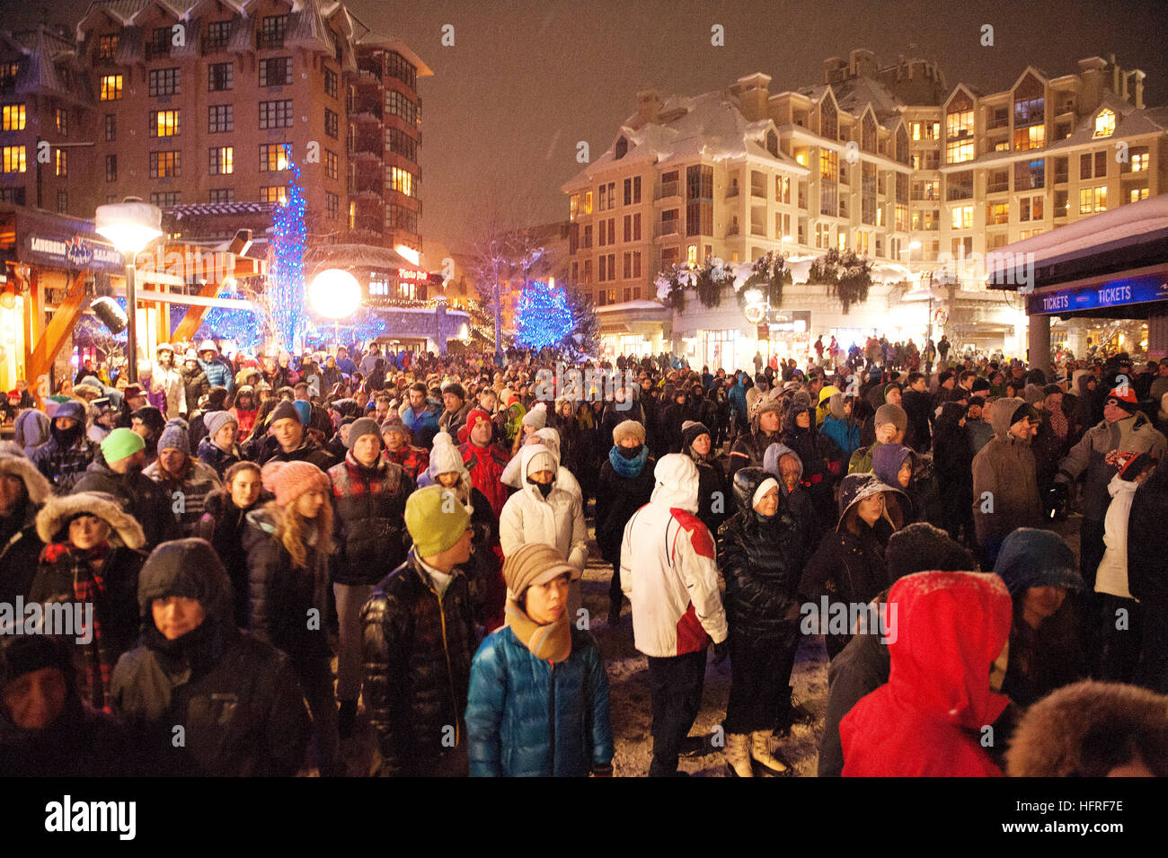 Crowds take in the New Year's Eve Fire & Ice show at the Skier's Plaza in the Whistler Village. Whistler - Stock Image