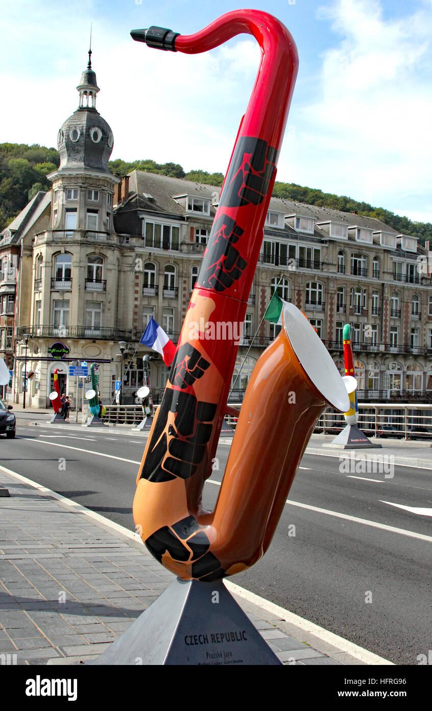 The Czech Republic saxophone sculpture graces the bridge in Dinant Belgium over the Meuse River. Stock Photo