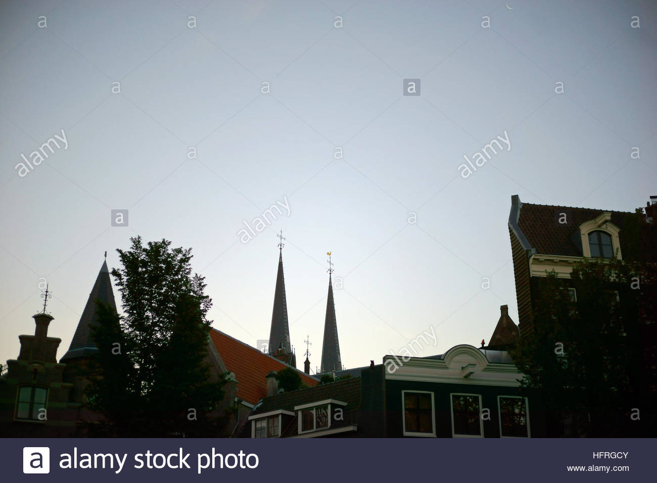Sunrise over the rooftops of canal houses in Amsterdam, Netherlands. - Stock Image