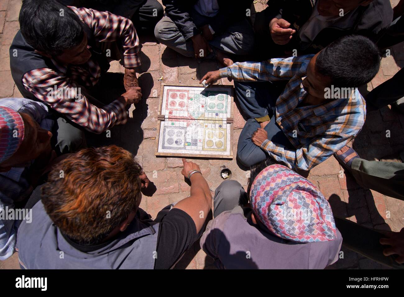 Nepal Kathmandu Asia street scene candid board game playing local - Stock Image