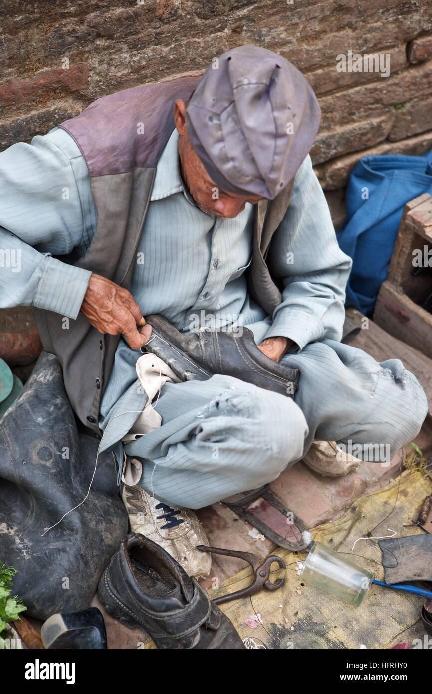 Nepal shoe repair man local vendor