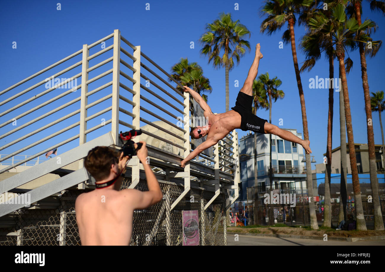Finnish athlete and coach, Aaro Helander, practicing in Venice Beach Calisthenics park, Los Angeles. Stock Photo