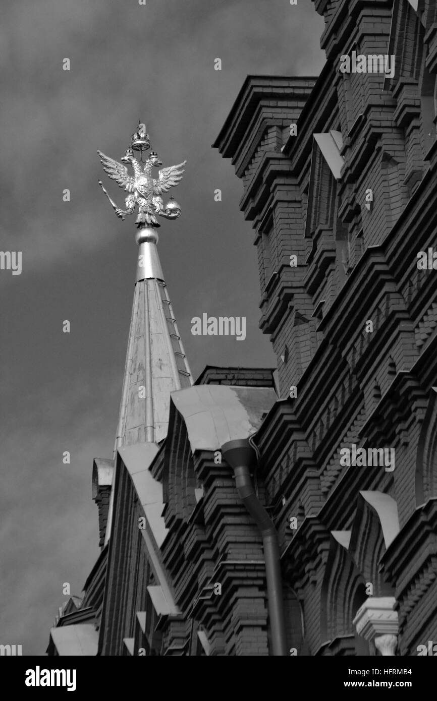 Black and White images of the contrasting sky and golden Russian Eagle, the Kremlin, Moscow, Russia - Stock Image