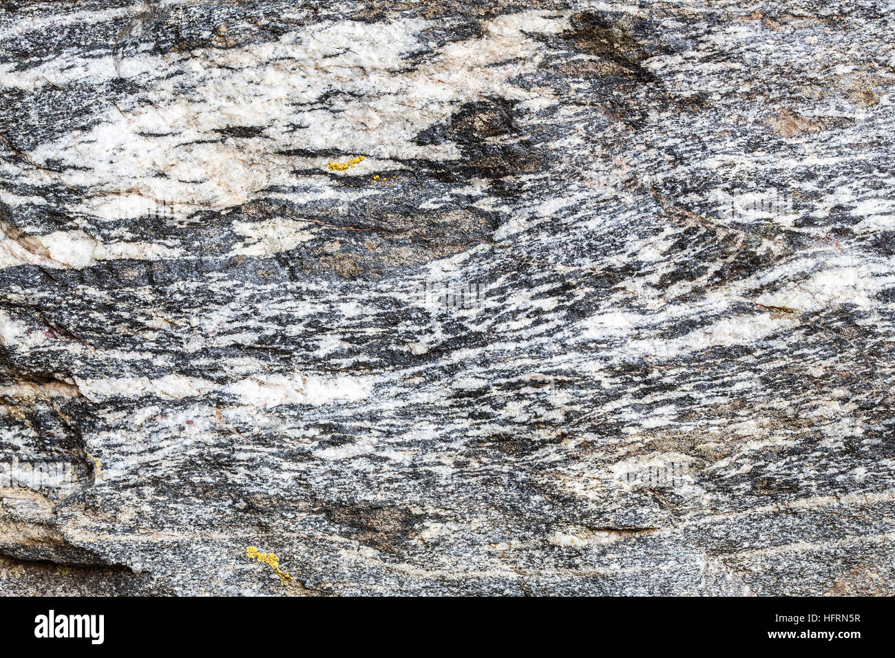 Granite stone texture, wall close-up - Stock Image