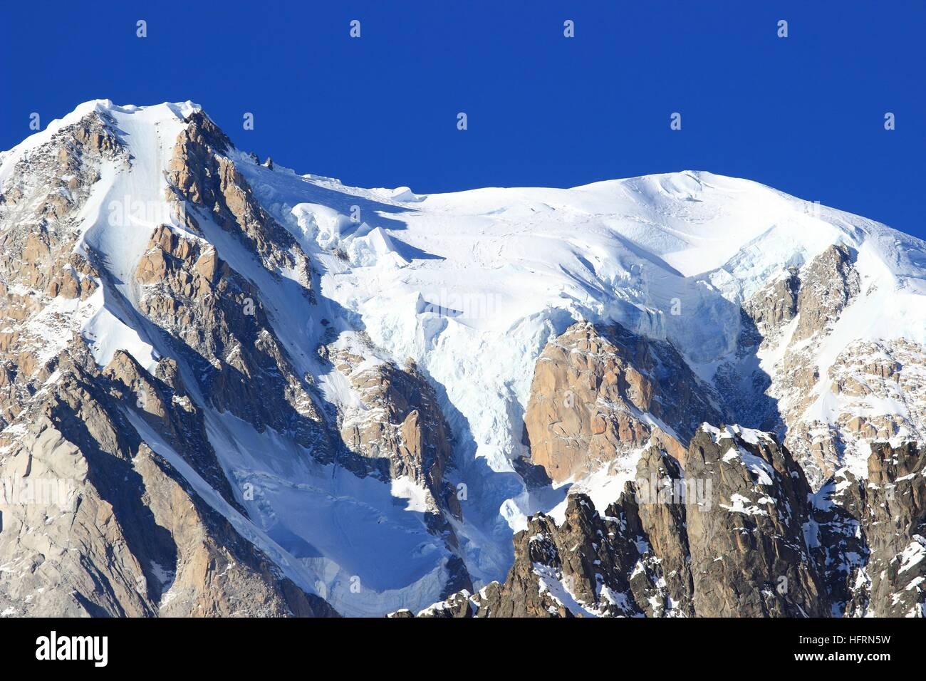 Mont Blanc peak on France- Italy border. Highest peaks in Alps. Stock Photo