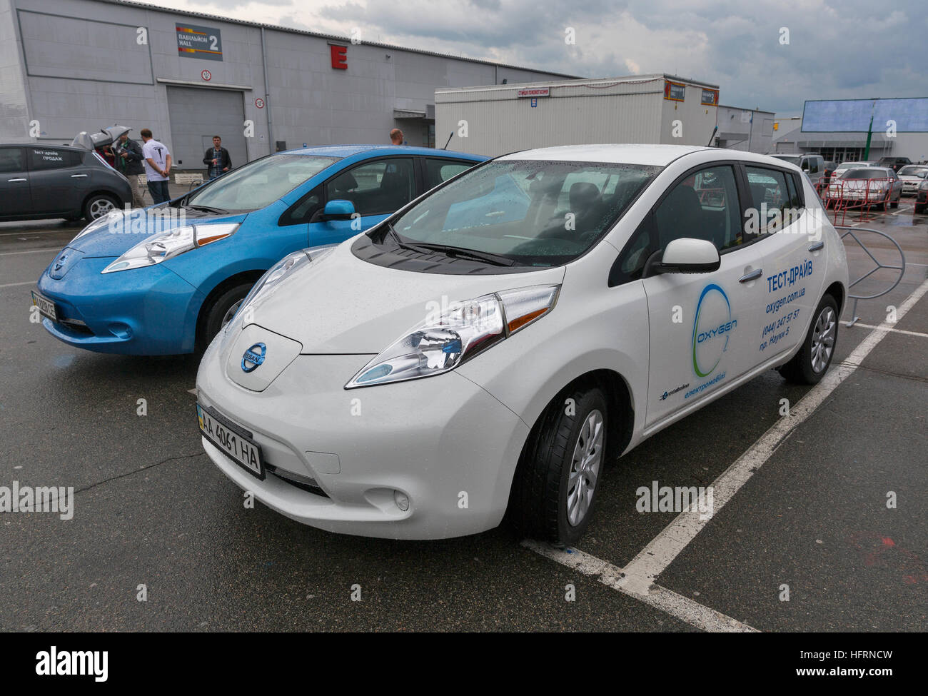 Visitors visit Oxygen Nissan Leaf electric hybrid cars parked ...