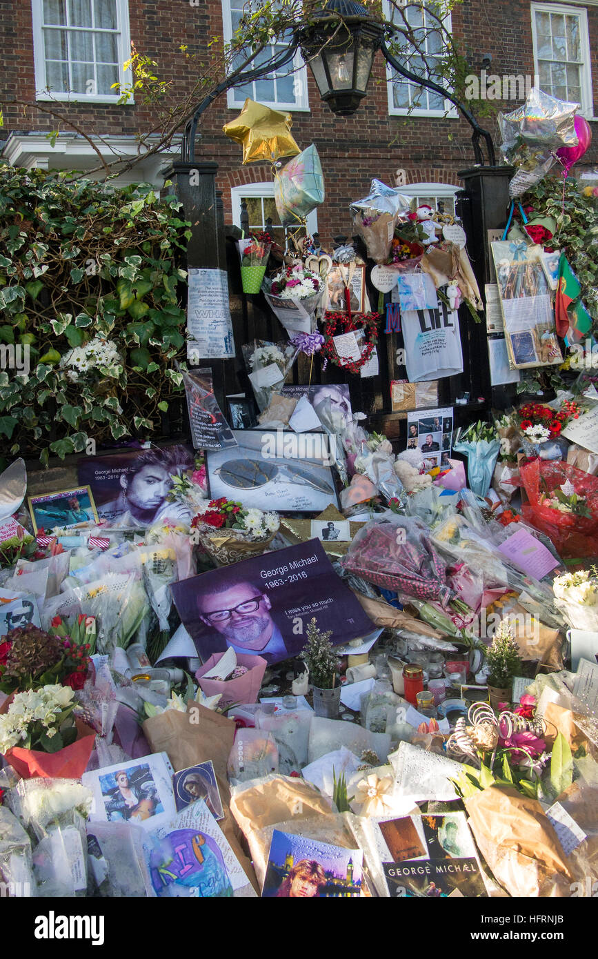 Tributes to George Michael outside his home in Highgate North London UK - Stock Image
