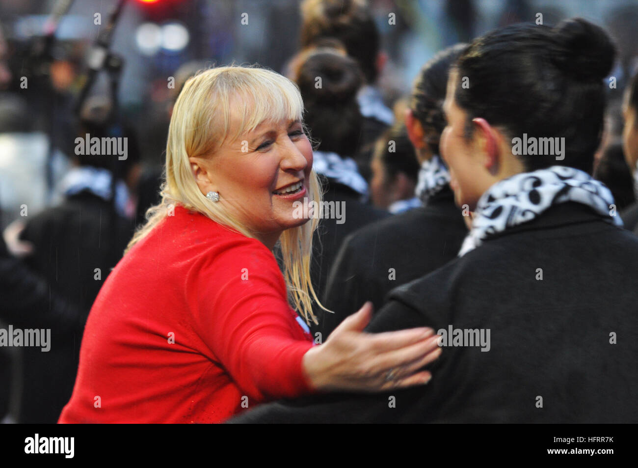 Soprano Susan Robertson congratulating a backing singer after the grand finale of London's New Year's Day Parade - Stock Image