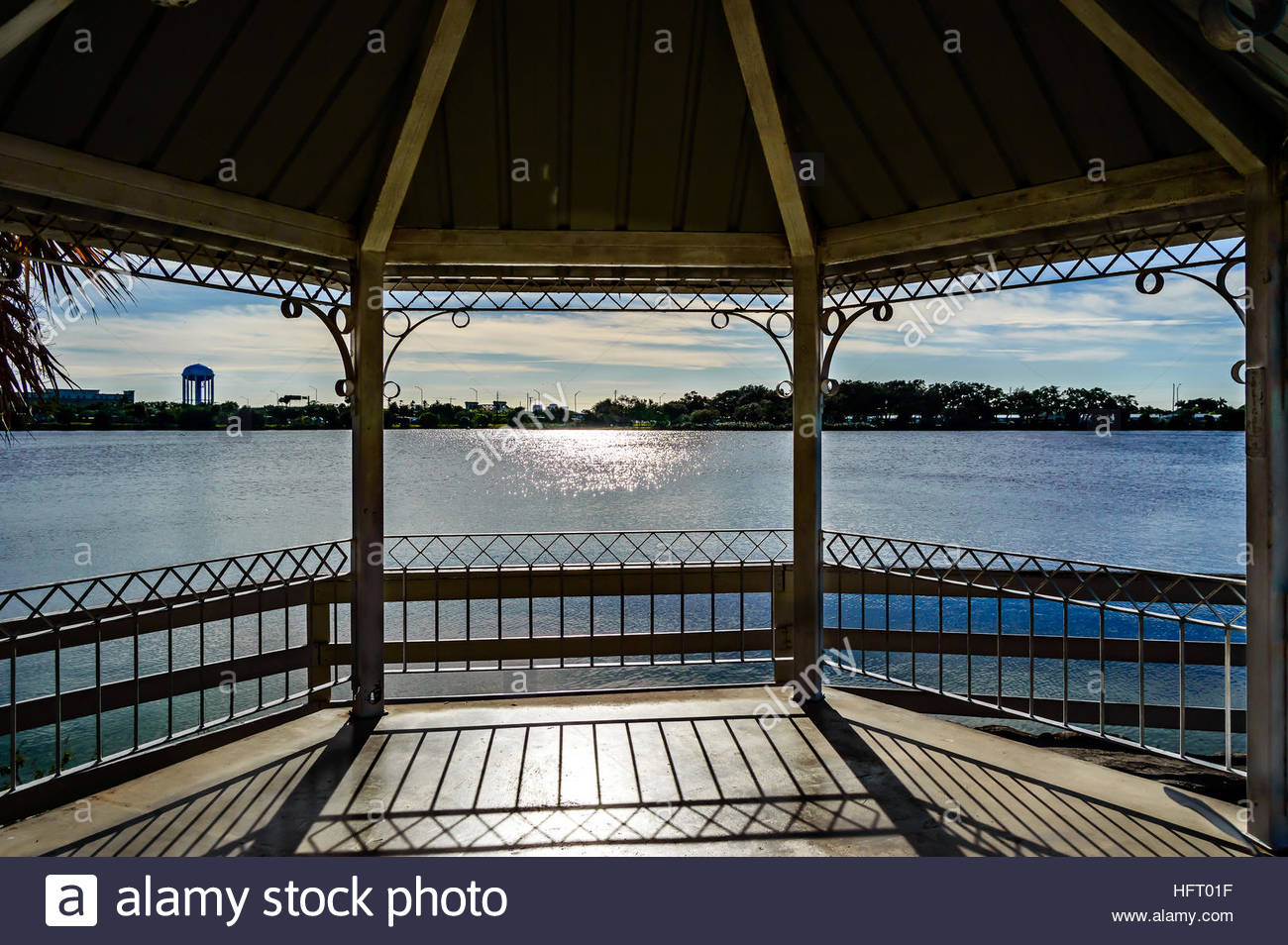 Photo showing the lake from inside the Gazebo and the sun glaring on the lake and floor. Stock Photo