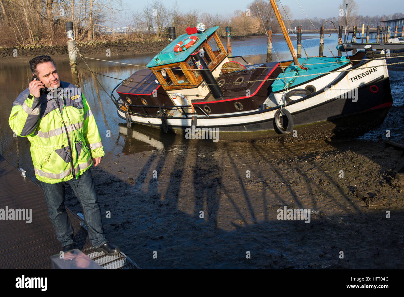 Water level of the river Maas dropped three meters due to an dysfunctional weir. - Stock Image