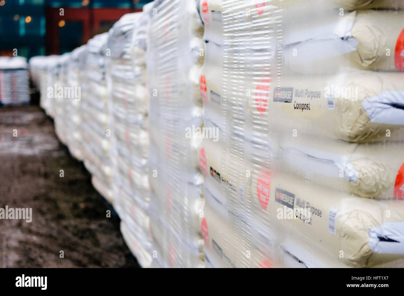 Wrapped pallets of multi-purpose compost at Homebase. - Stock Image