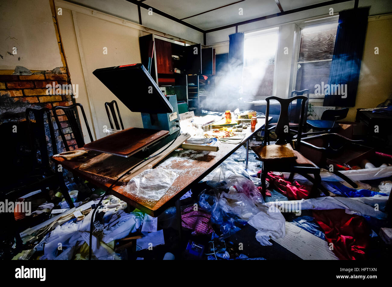 Very dirty room in a house belonging to someone who hoards rubbish - Stock Image