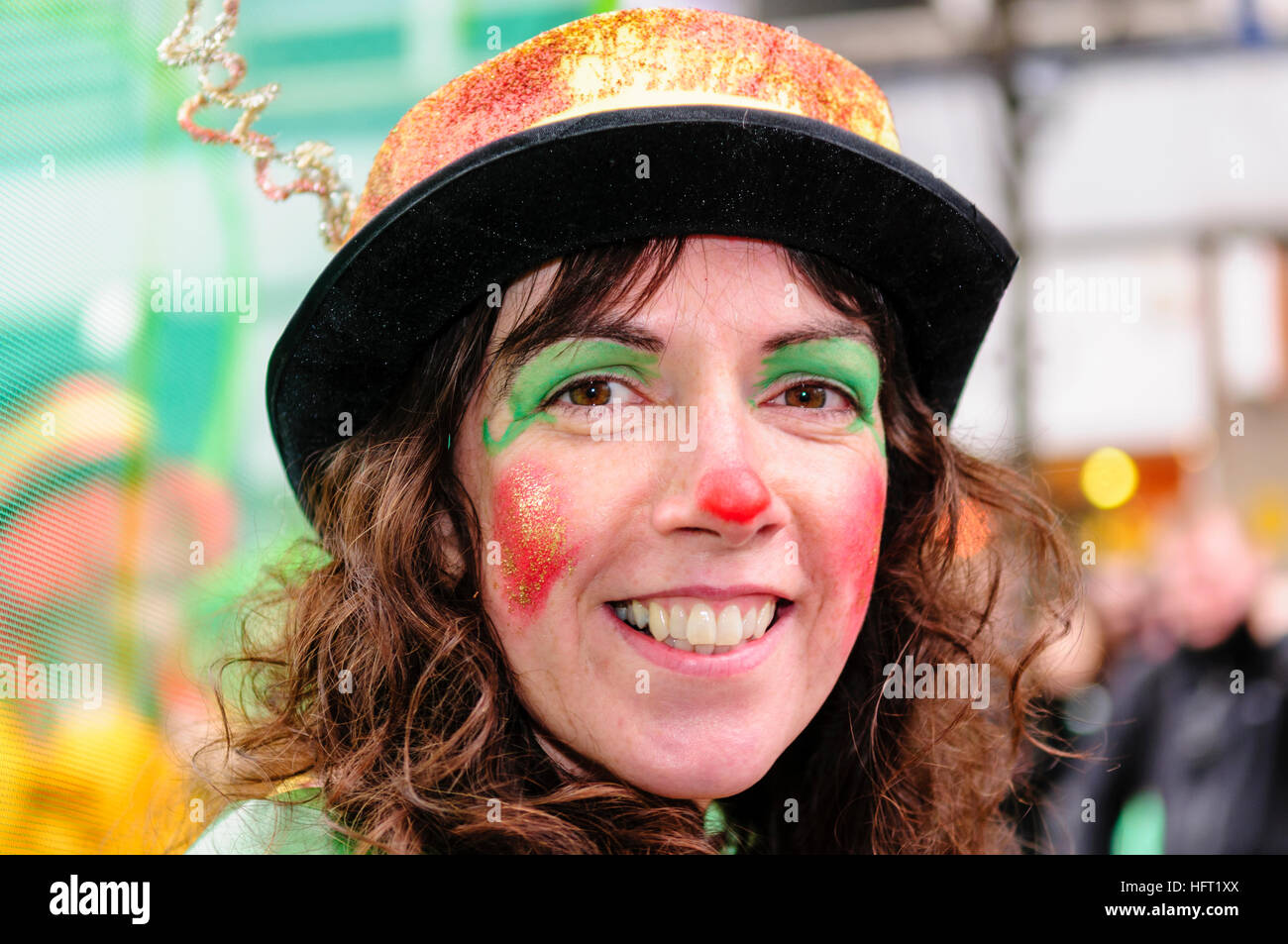 A woman with facepaint takes part in a circus performance - Stock Image