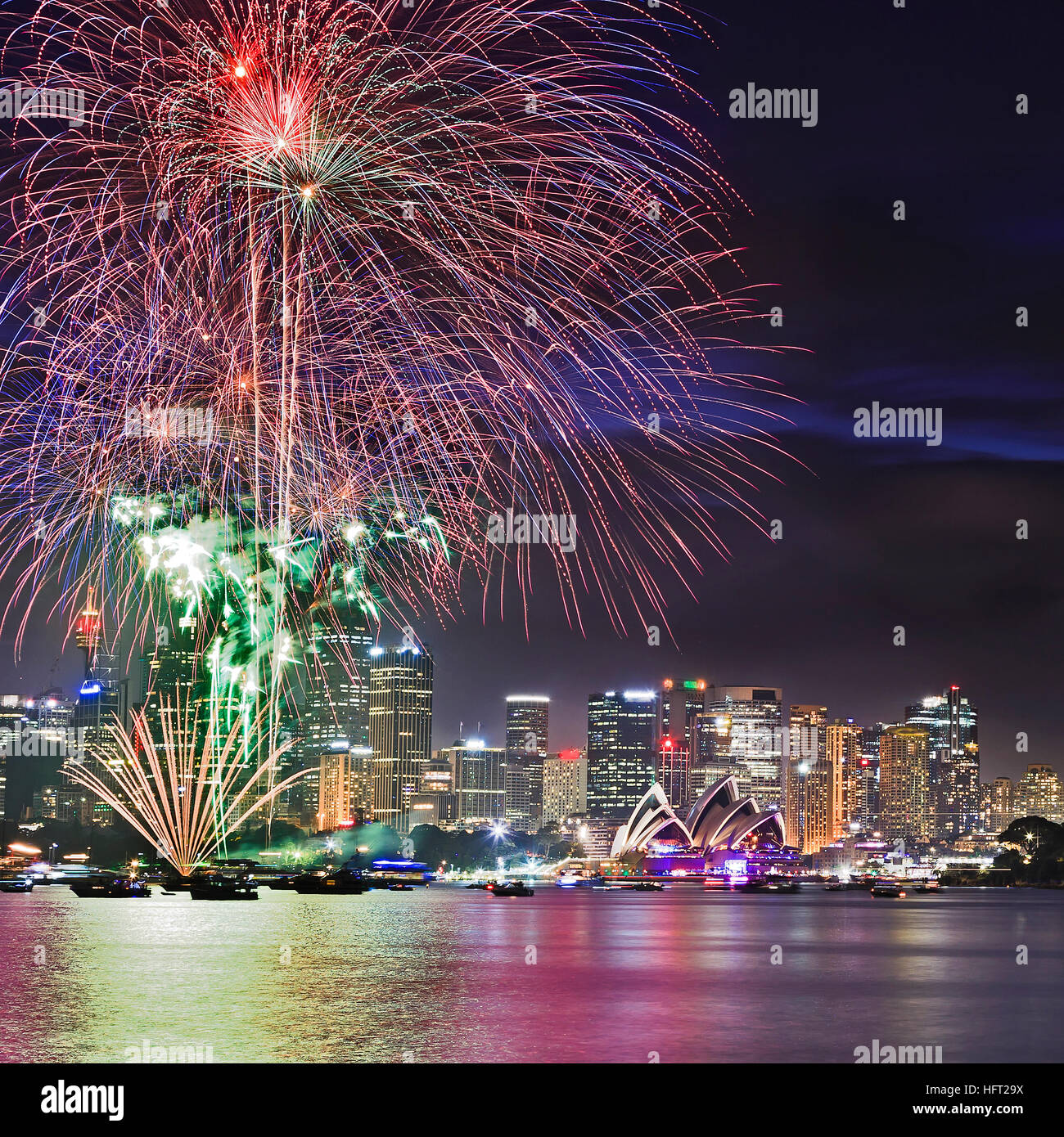 Close up view of Sydney New Year Eve Fireworks across Harbour above city CBD landmarks and towers. - Stock Image