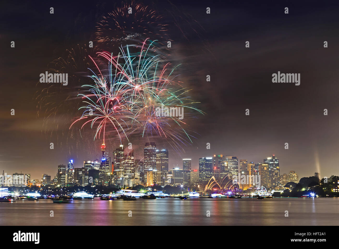 New year eve fireworks in Sydney over Harbour waters above city CBD - bright multi-colour light balls in the sky. - Stock Image