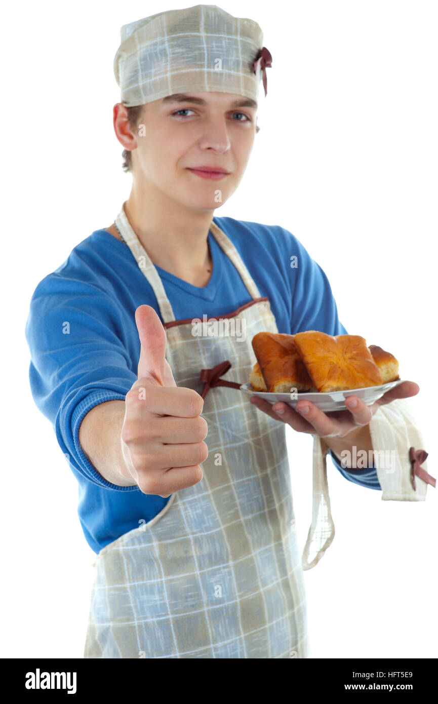 Cook with the pastry on a white background - Stock Image