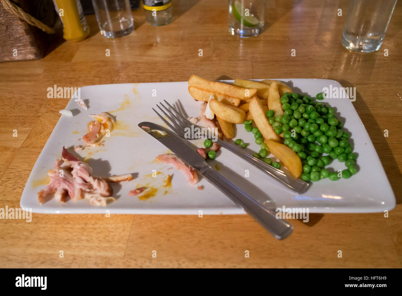 The remains of a meal. - Stock Image