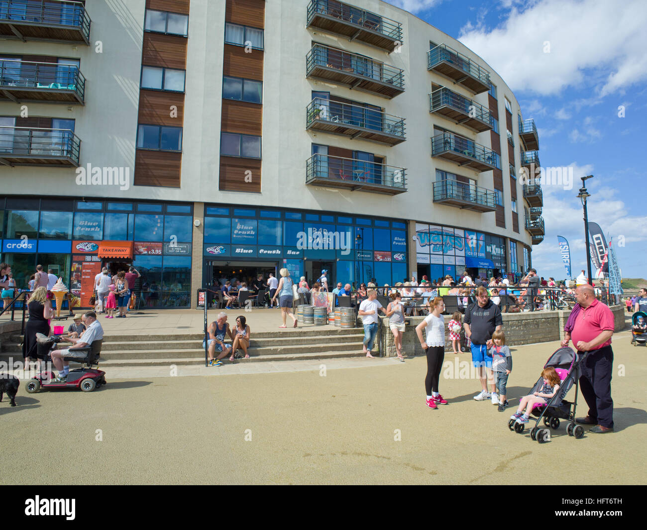 Tourists holiday makers The Sands North Bay Scarborough North Yorkshire Coast UK - Stock Image