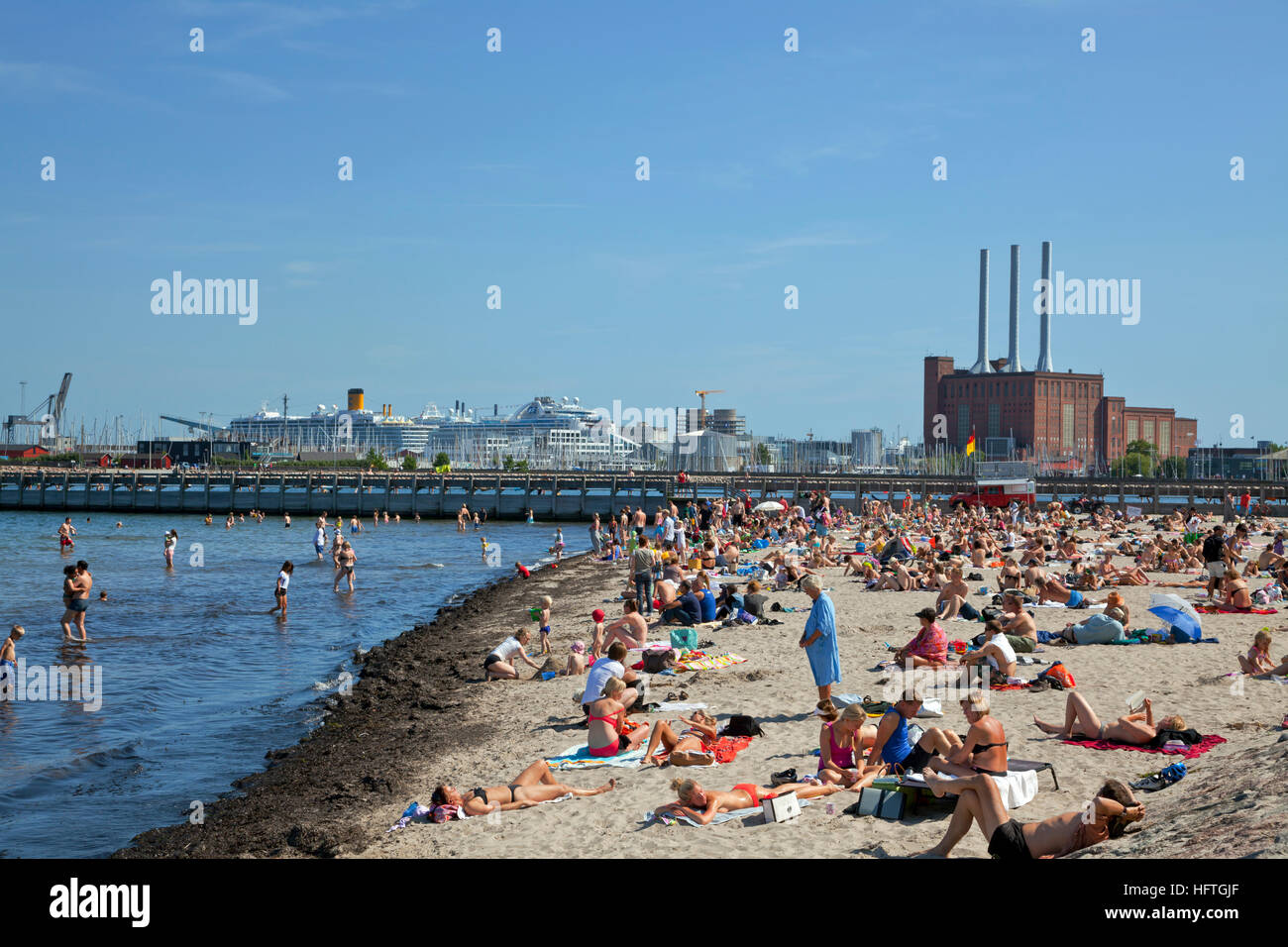 The Svanemølle Beach at the North Harbour of Copenhagen. 4,000 sqm. sand beach with a 130m long pier established - Stock Image