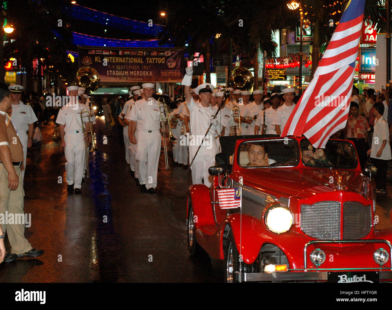 070831-N-5174T-019 KUALA LUMPUR, Malaysia (Aug. 31, 2007) - The Pacific Fleet Band performs in a parade in Kuala - Stock Image