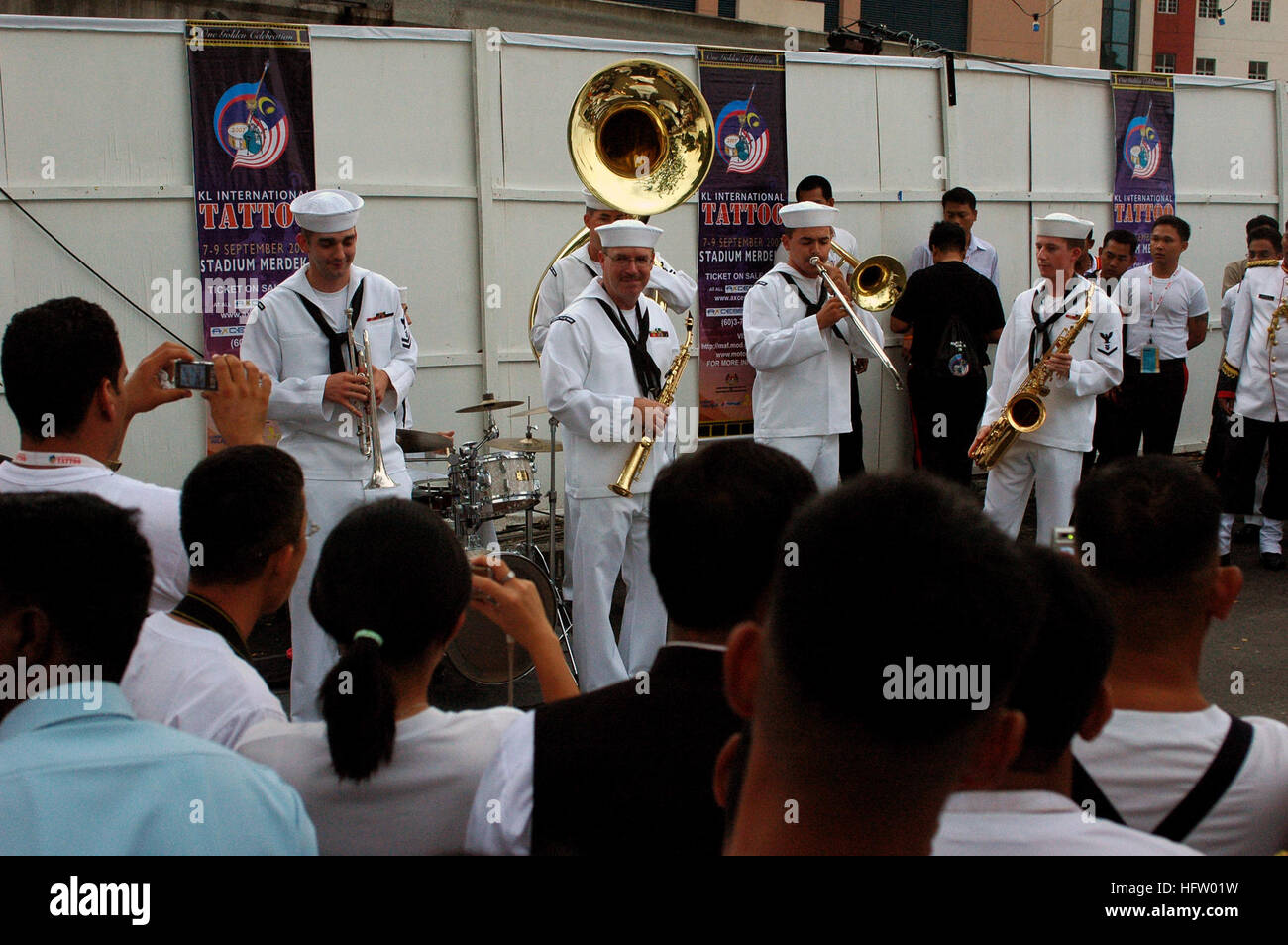 070907-N-5174T-007  KUALA LUMPUR, Malaysia (Sept. 7, 2007) - Sailors attached to the Pacific Fleet Band perform - Stock Image