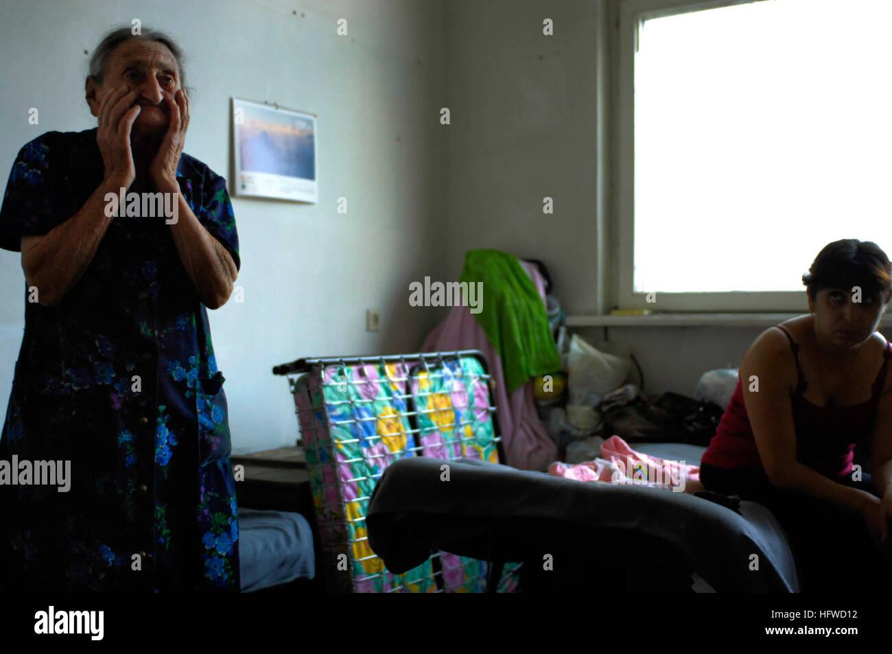 080828-F-0560B-015 TBILISI, Georgia (Aug. 28, 2008) A Georgian woman speaks about living conditions in a center - Stock Image