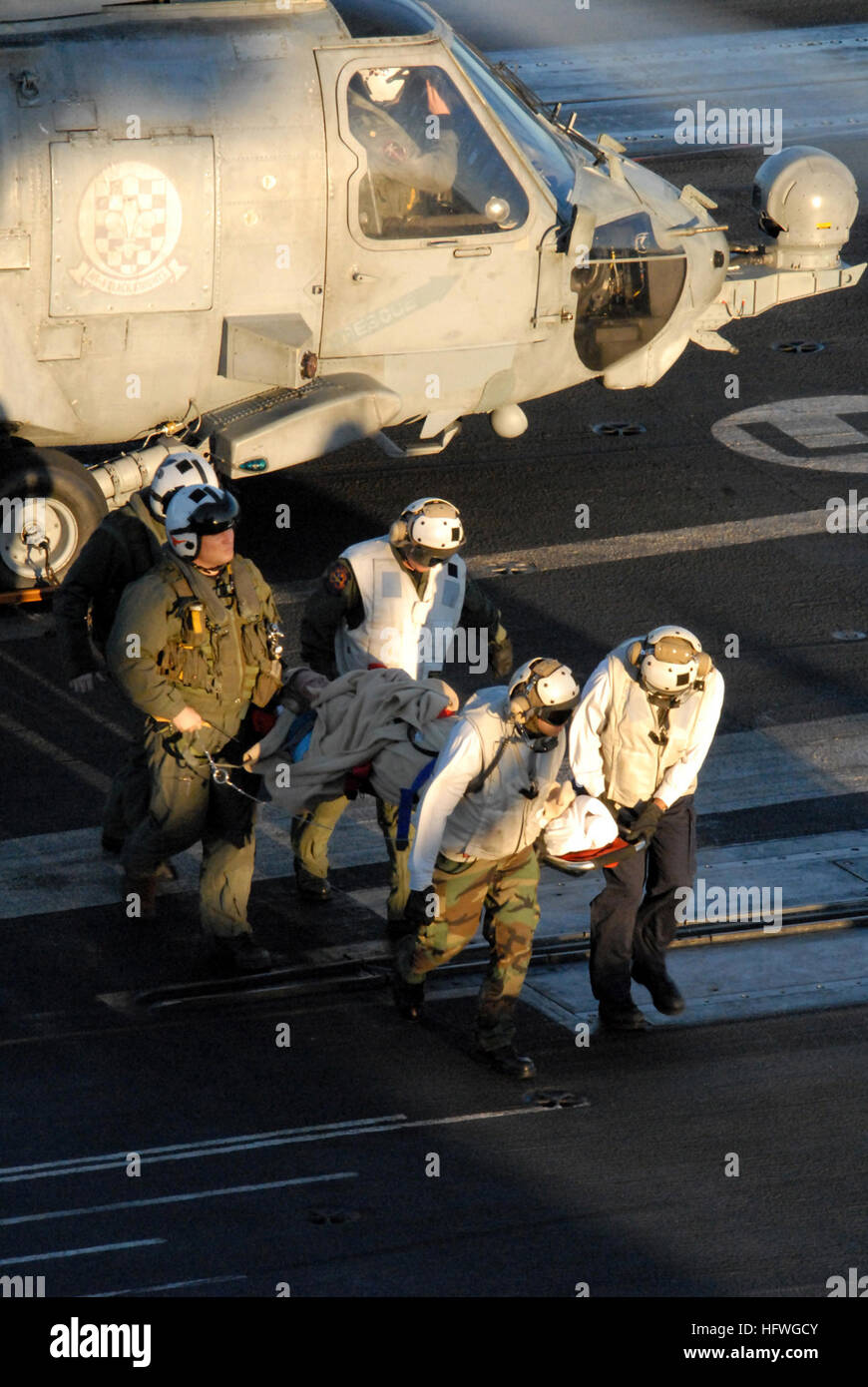 Medical personnel aboard the aircraft carrier USS Ronald Reagan (CVN 76) help unload a patient from an HH-60H Seahawk Stock Photo