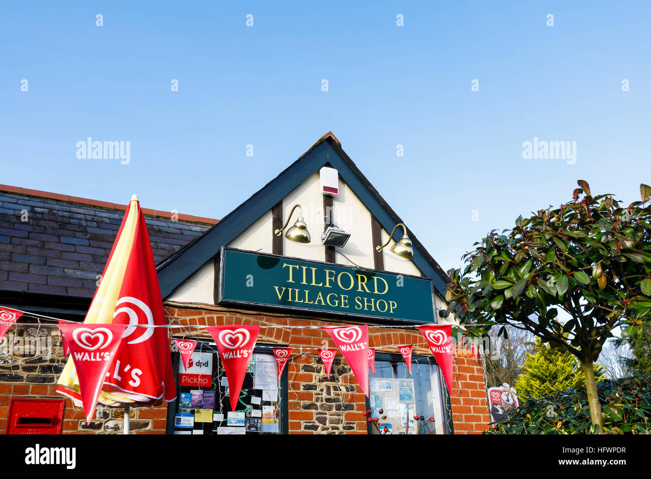 Exterior of Tilford village shop, Tilford, near Farnham, Surrey, UK - Stock Image