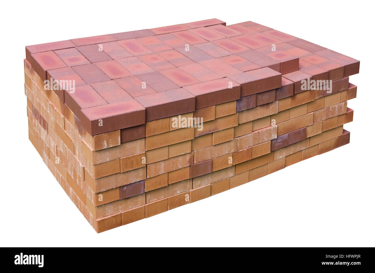 Accurate big stack of red clay bricks for a construction of the rural house. Isolated on white - Stock Image
