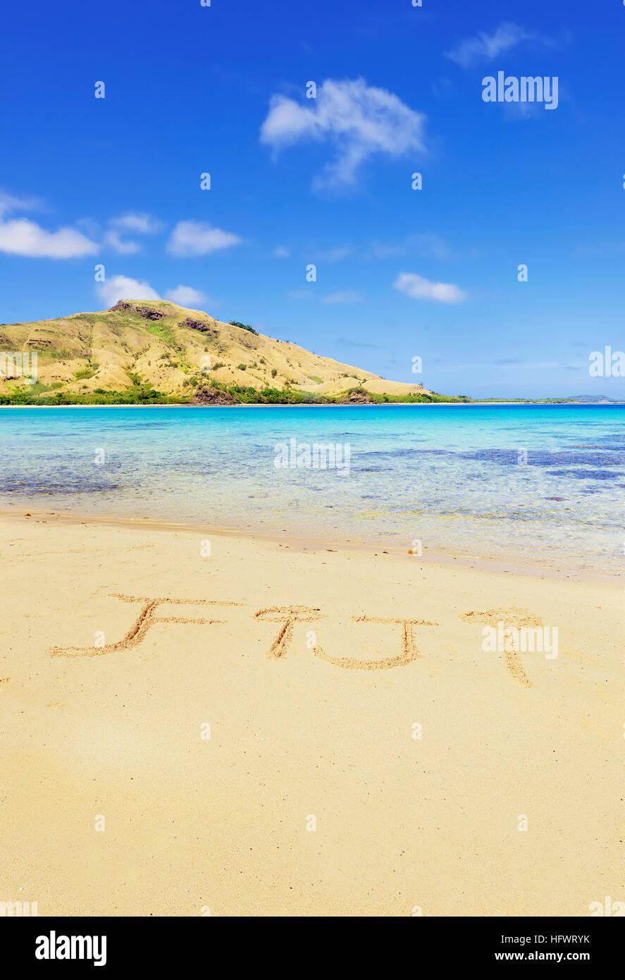 'Fiji' written in sand, Yasawa Group, Fiji, South Pacific islands, Pacific - Stock Image