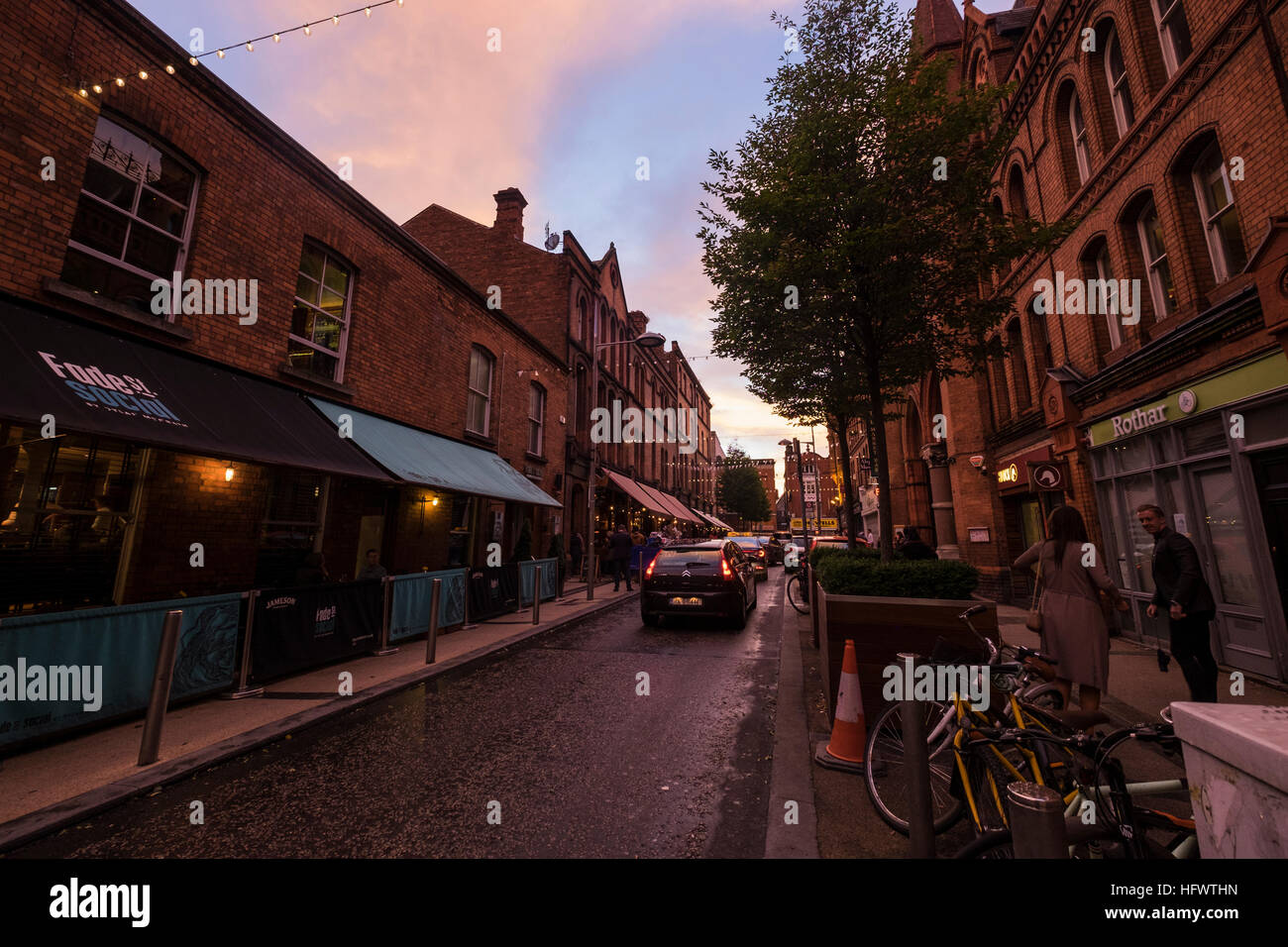 Red brick buildings at dusk in Fade Street, Dublin, Ireland - Stock Image