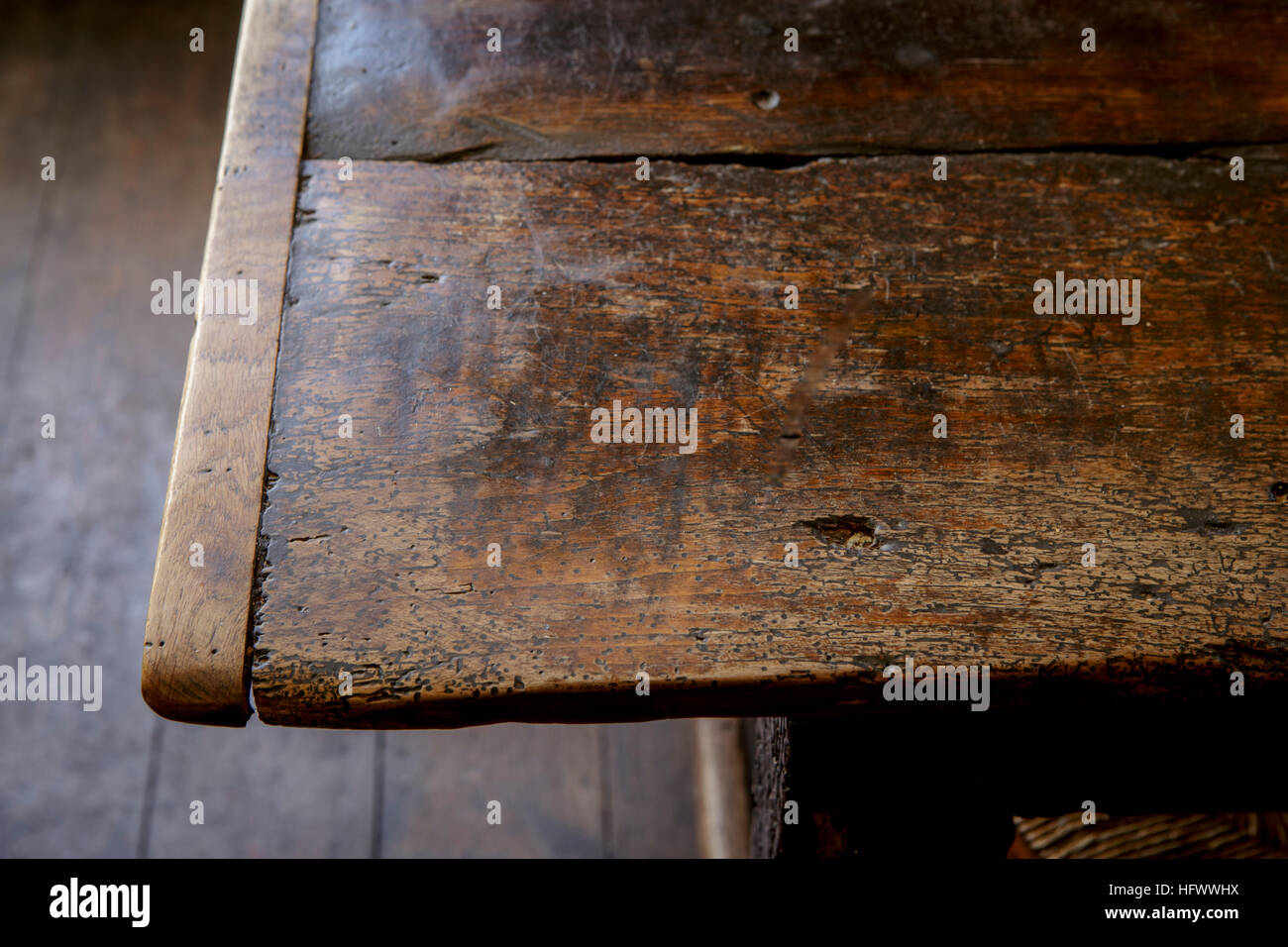 Old Pub or public house, detail of wooden table with knots and patina - Stock Image