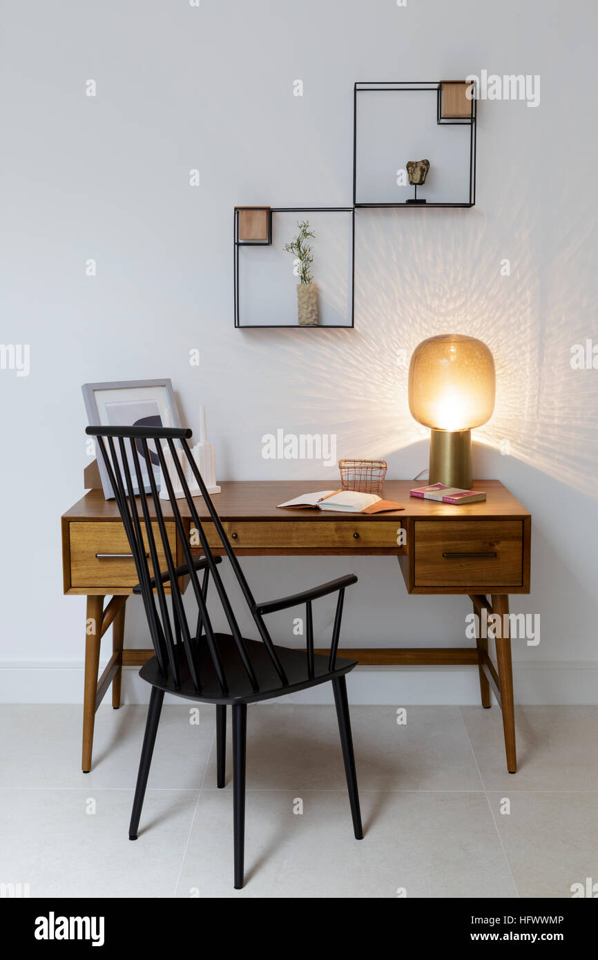 Desk in modern study with stylish mid century style furniture