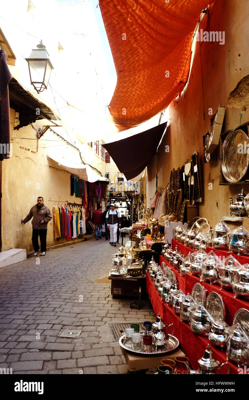 Silver teapots for sale in the narrow streets of Fez medina, Morocco. - Stock Image