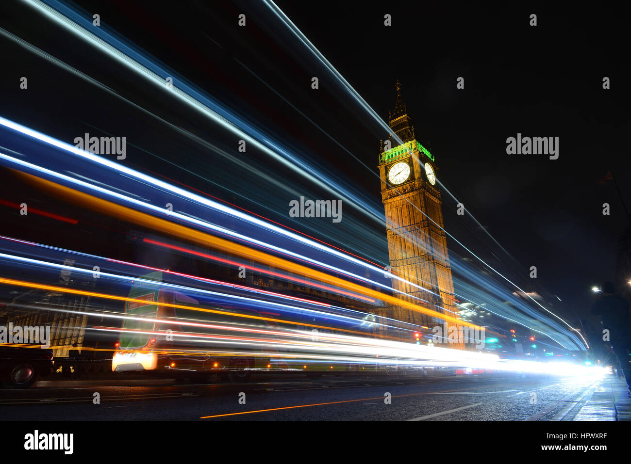 Big Ben tower, Westminster Palace, London, UK, at night with car trails - Stock Image