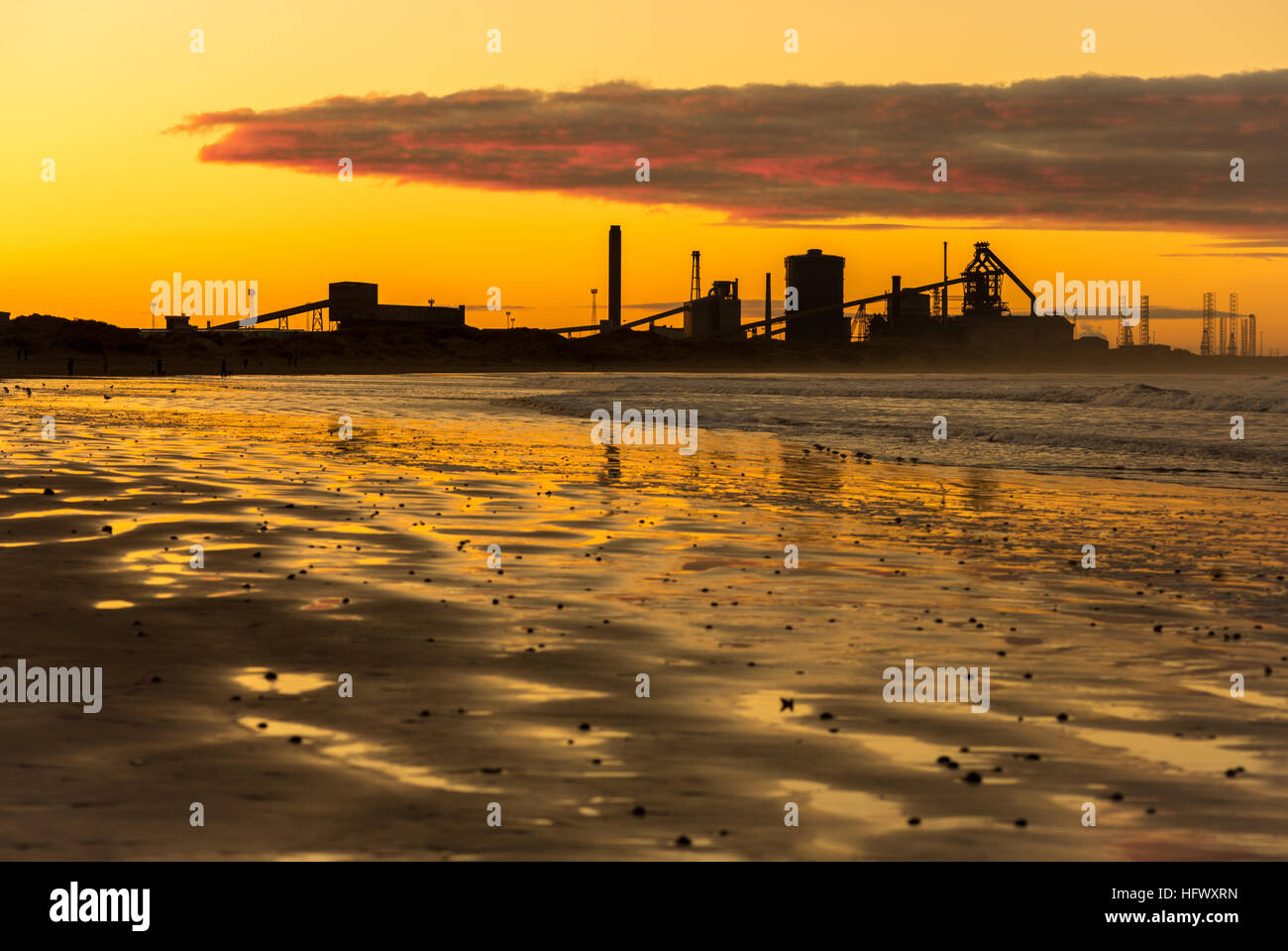 Redcar steelworks in silhouette at sunset - Stock Image