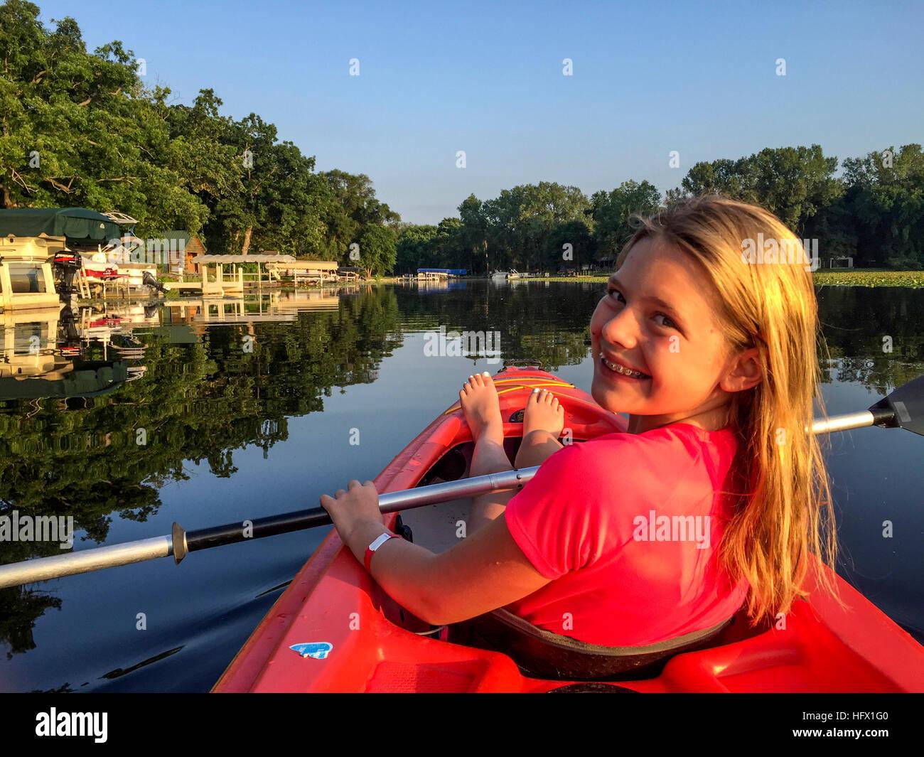 Twelve-year-old Girl in her Kayak.  Eagle Springs Lake, Wisconsin, USA. - Stock Image