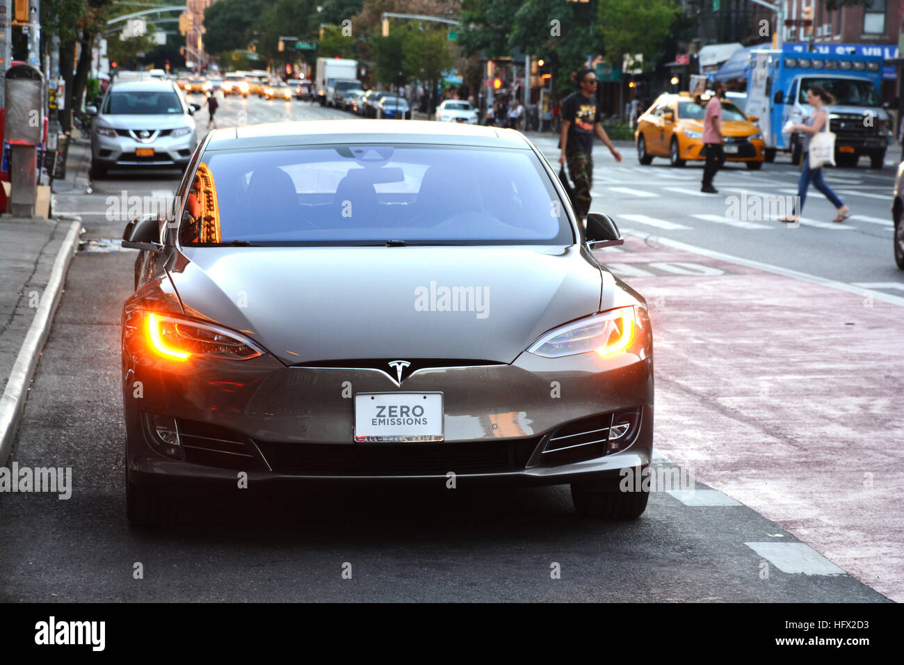 Zero Pollution Motors >> Tesla electric car with ZERO EMISSIONS text on the license plate Stock Photo: 130265103 - Alamy