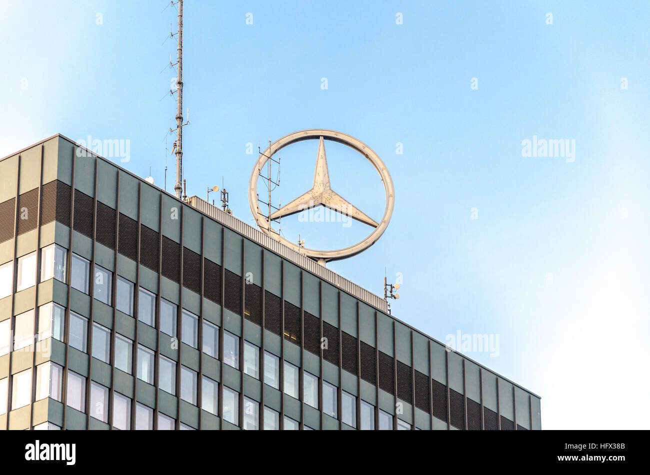 Mercedes-Benz logo on top of the high-rise tower at the Europa-Center. Breitscheidplatz, Berlin, Germany - Stock Image