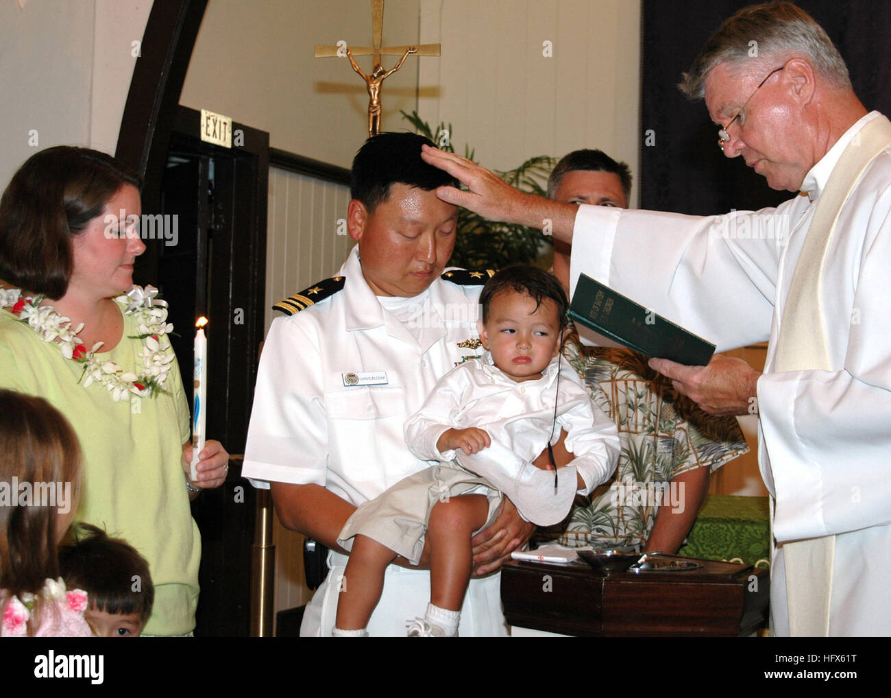 050711-N-5783F-001 Pearl Harbor, Hawaii (July 11, 2005) Ð Lt. Cmdr. Chris Buziak is blessed by Father Patrick - Stock Image