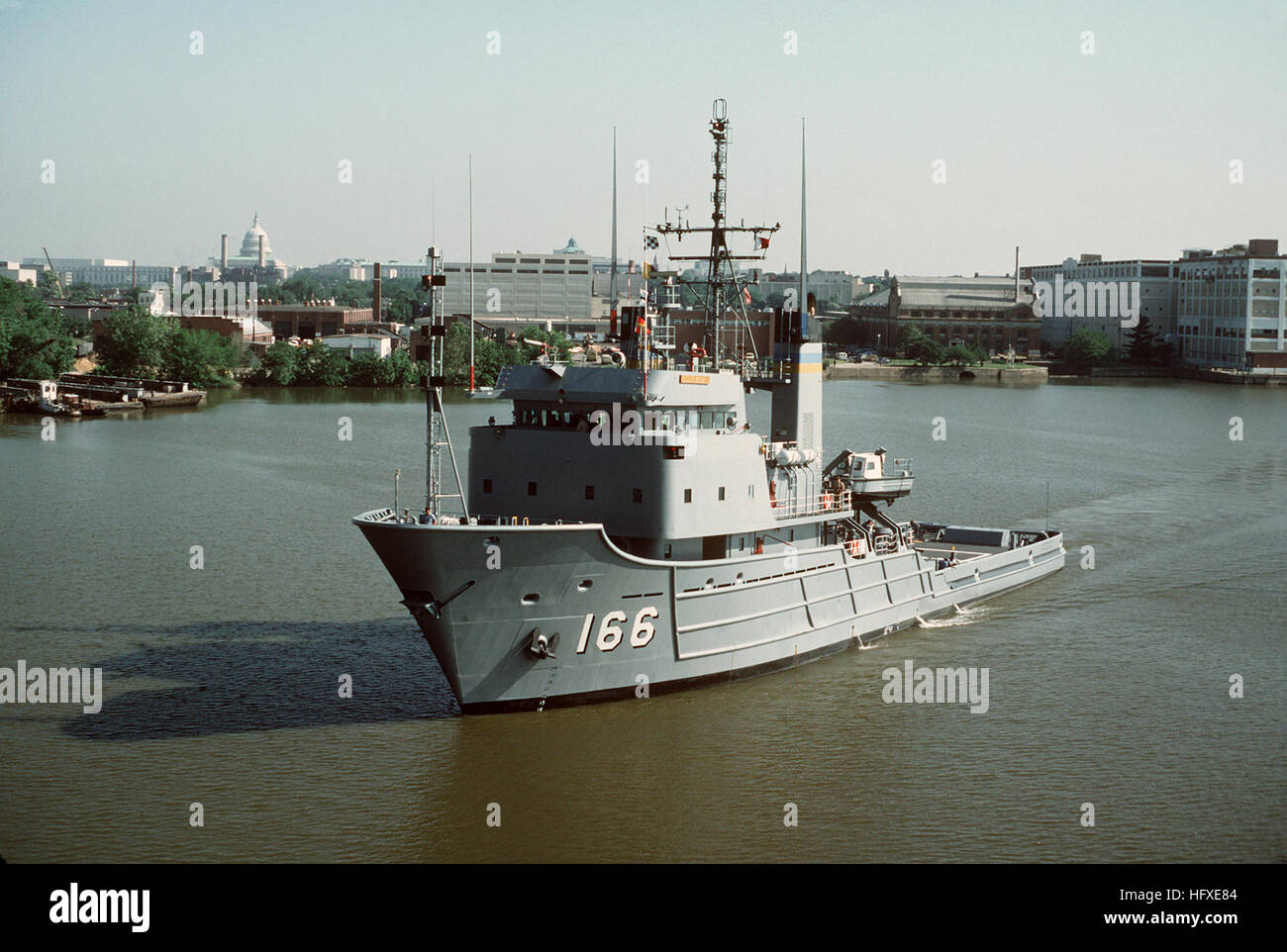 A port bow view of the fleet tug USNS POWHATAN (T-ATF 166) underway on the Anacostia River after departing the Washington Stock Photo