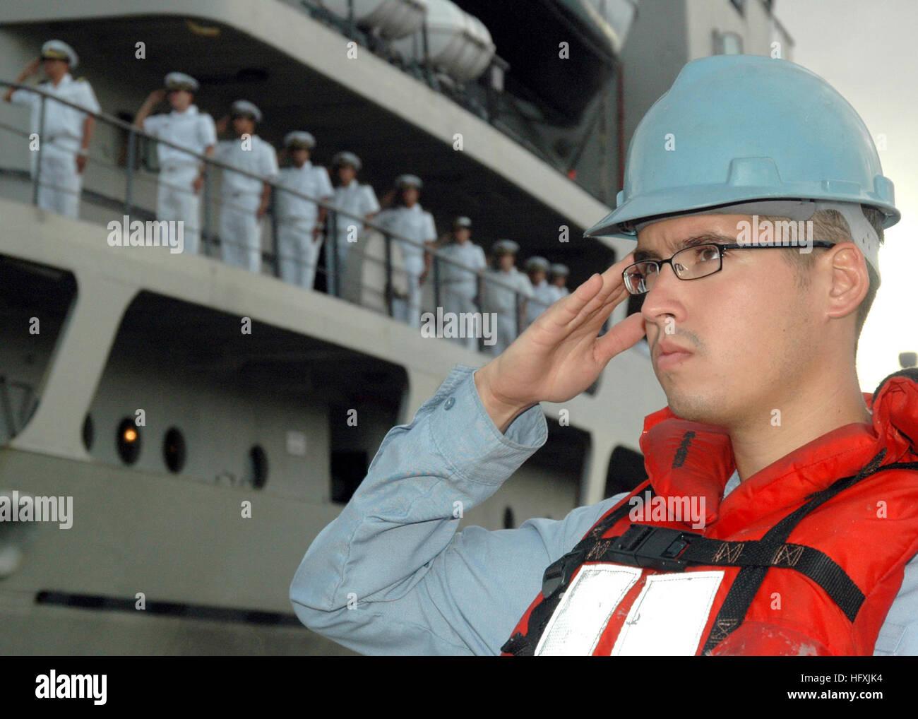 060125-N-3019M-001 Pearl Harbor, Hawaii (Jan. 25, 2006) - Sonar Technician 3rd Class Donnie Garrison salutes the Stock Photo
