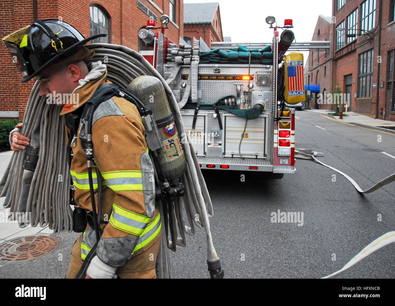 090723-N-8732C-003  WASHINGTON (July 23, 2009) A Naval Support Activity Washington (NSAW) firefighter pulls hose Stock Photo